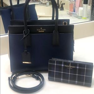 Kate Spade navy purse with matching wallet.